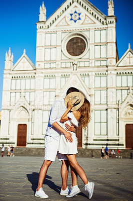 Buy stock photo Shot of an affectionate young couple spending a romantic day in the city of Florence