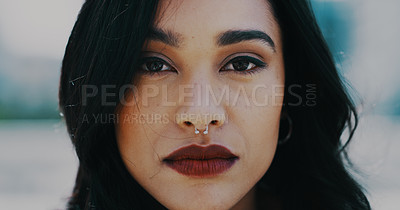 Buy stock photo Closeup shot of a beautiful young woman spending the day out in the city