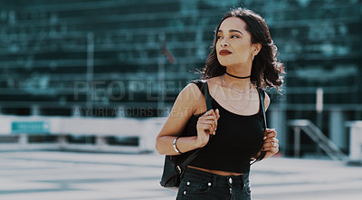 Buy stock photo Cropped shot of a beautiful young woman spending the day out in the city