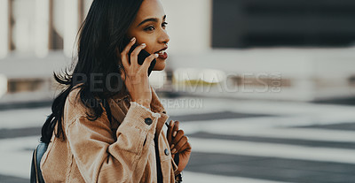 Buy stock photo Cropped shot of a young woman using her cellphone while out in the city