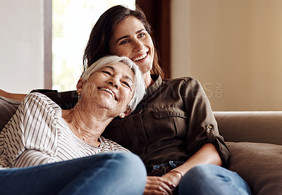 Buy stock photo Shot of a young woman spending quality time with her elderly mother at home