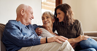 Buy stock photo Shot of a happy family relaxing together on the sofa at home