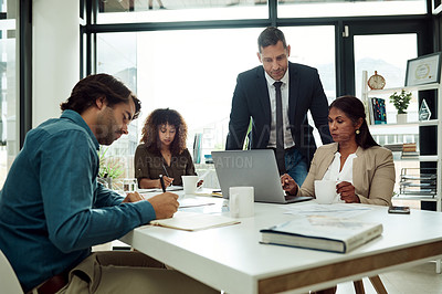 Buy stock photo Shot of corporate businesspeople working in their office