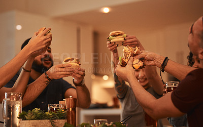 Buy stock photo Shot of a group of young friends getting together for drinks and good food at a restaurant
