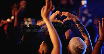Buy stock photo Rearview shot of unrecognizable people making a heart shape during a concert in a nightclub