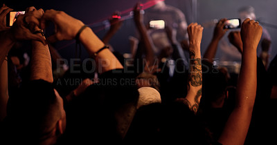 Buy stock photo Rearview shot of unrecognizable people holding up their camera phones during a concert in a nightclub