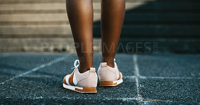 Buy stock photo Low angle shot of a woman out for a run