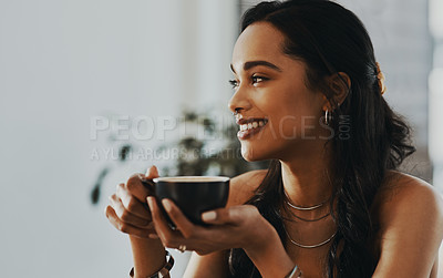 Buy stock photo Shot of a young woman having a coffee break at home