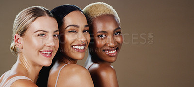 Buy stock photo Studio portrait of a group of attractive women posing together and smiling while standing against a grey background