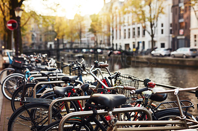 Buy stock photo Still life shot of a group of bicycles fastened onto railings in the city of Amsterdam, Netherlands