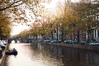 Buy stock photo Still life shot of a beautiful canal running across the city of Amsterdam in Netherlands