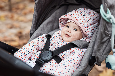 Buy stock photo Cropped shot of an adorable baby girl sitting inside her pram outdoors
