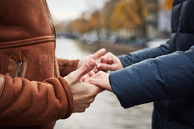 Buy stock photo Cropped shot of an unrecognizable couple holding hands while exploring a foreign city