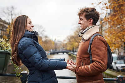 Buy stock photo Shot of an affectionate couple exploring a foreign city during the day