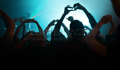 Buy stock photo Rearview shot of unrecognizable people making heart shapes during a concert  in a nightclub