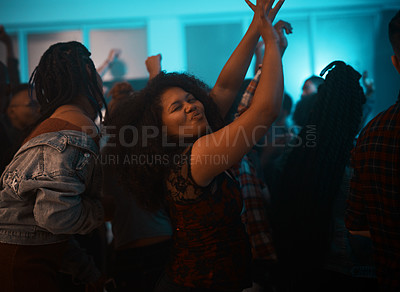 Buy stock photo Cropped shot of an attractive young woman dancing while partying in a nightclub
