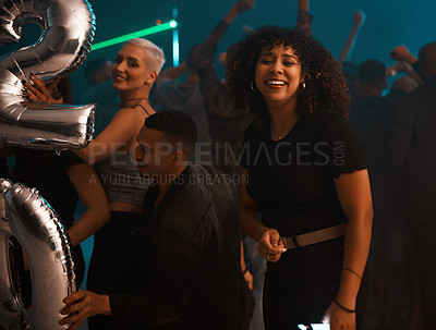 Buy stock photo Cropped shot of a group of young friends partying on new year's eve in a nightclub