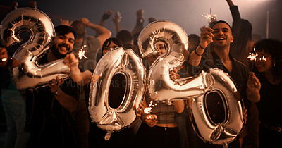 Buy stock photo Cropped shot of a group of young friends holding up sparklers and balloons that read