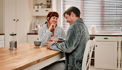 Buy stock photo Cropped shot of a couple having their morning coffee in their kitchen