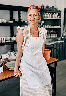 Buy stock photo Cropped portrait of an attractive mature woman standing alone in her pottery workshop during the day