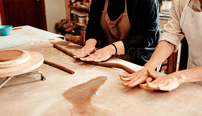 Buy stock photo Cropped shot of two artisans working together in a pottery workshop