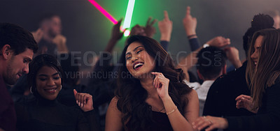 Buy stock photo Cropped shot of an attractive young woman dancing in a nightclub
