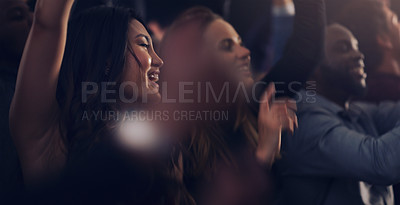 Buy stock photo Cropped shot of a group of young friends dancing together in a nightclub