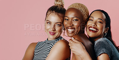 Buy stock photo Studio portrait of a diverse group of beautiful young women smiling while standing against a pink background