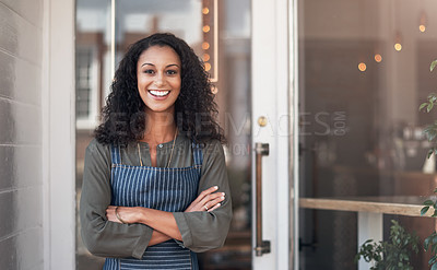 Buy stock photo Portrait of a young woman standing outside her cafe