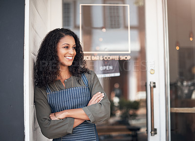 Buy stock photo Shot of a young woman standing outside her cafe
