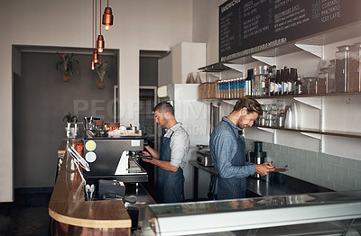 Buy stock photo Shot of two men working in a cafe