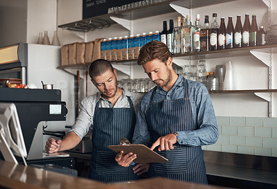 Buy stock photo Shot of two men working together in a cafe