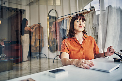 Buy stock photo Cropped shot of a small business owner working in her boutique
