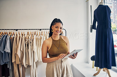 Buy stock photo Cropped shot of a boutique owner using a digital tablet in her store