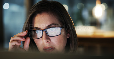Buy stock photo Closeup shot of an attractive young businesswoman looking shocked while working late in a modern office