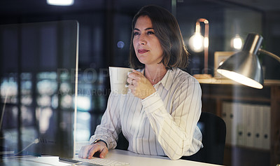Buy stock photo Cropped shot of an attractive young businesswoman drinking coffee while working late in a modern office