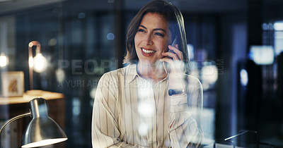 Buy stock photo Cropped shot of an attractive young businesswoman taking a phonecall while working late in a modern office
