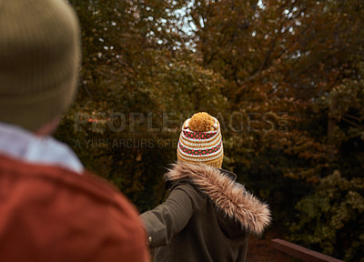 Buy stock photo Cropped shot of an unrecognizable woman pulling her boyfriend's hand in a park in late autumn