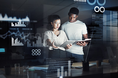 Buy stock photo Cropped shot of three confident young programmers having a discussion together while standing and working next to a computer inside of their office at night