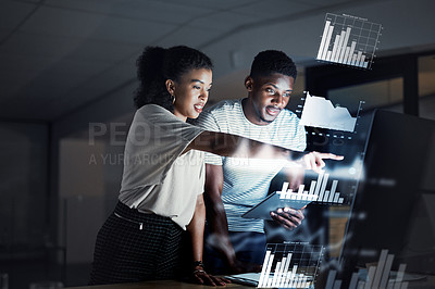 Buy stock photo Cropped shot of two confident  young programmers working together late at night in their office