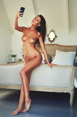 Buy stock photo Shot of an attractive young woman posing nude in her bedroom