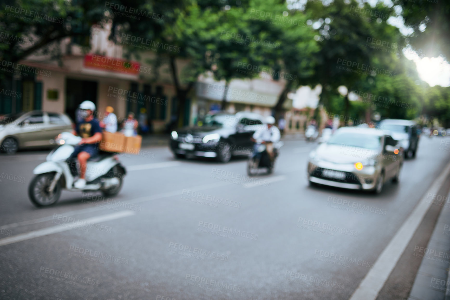 Buy stock photo Shot of vehicles traveling through the streets of Vietnam