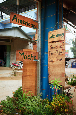 Buy stock photo Shot of signs hanging outside of a cafe in a Vietnamese town