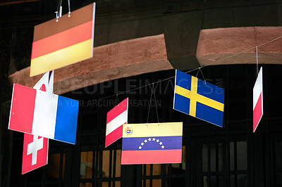 Buy stock photo Shot of a variety of flags hanging outside a tourist attraction in Vietnam