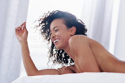 Buy stock photo Cropped shot of a gorgeous young woman posing topless on her bed at home