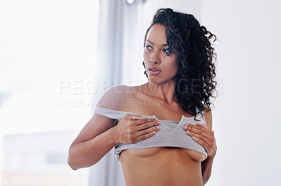 Buy stock photo Cropped shot of a gorgeous young woman posing seductively in her bedroom at home