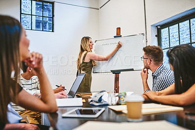 Buy stock photo Cropped shot of an attractive young businesswoman giving a presentation during a seminar in a modern office