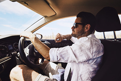 Buy stock photo Shot of a young man driving a car