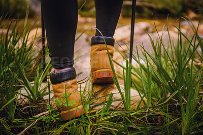 Buy stock photo Closeup shot of an unrecognisable woman's feet while out for a hike