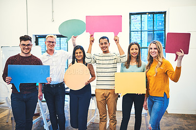 Buy stock photo Portrait of a group of businesspeople holding speech bubbles in a modern office